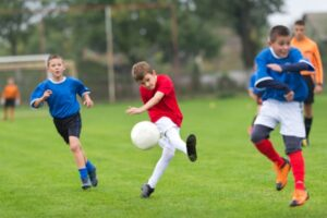 How does sports affect our bodies_Kids Playing Soccer